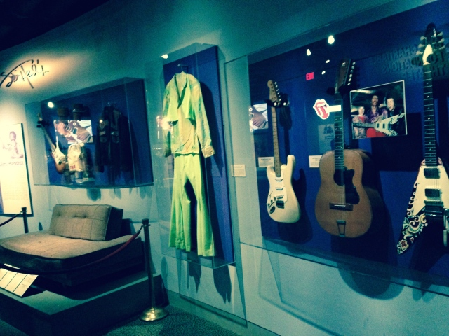 Jimi Hendrix exhibit, portion, including guitars, costumes, couch from home.